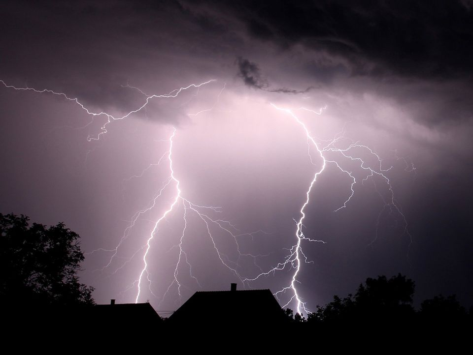 What happens when lightning strikes a metal roof?